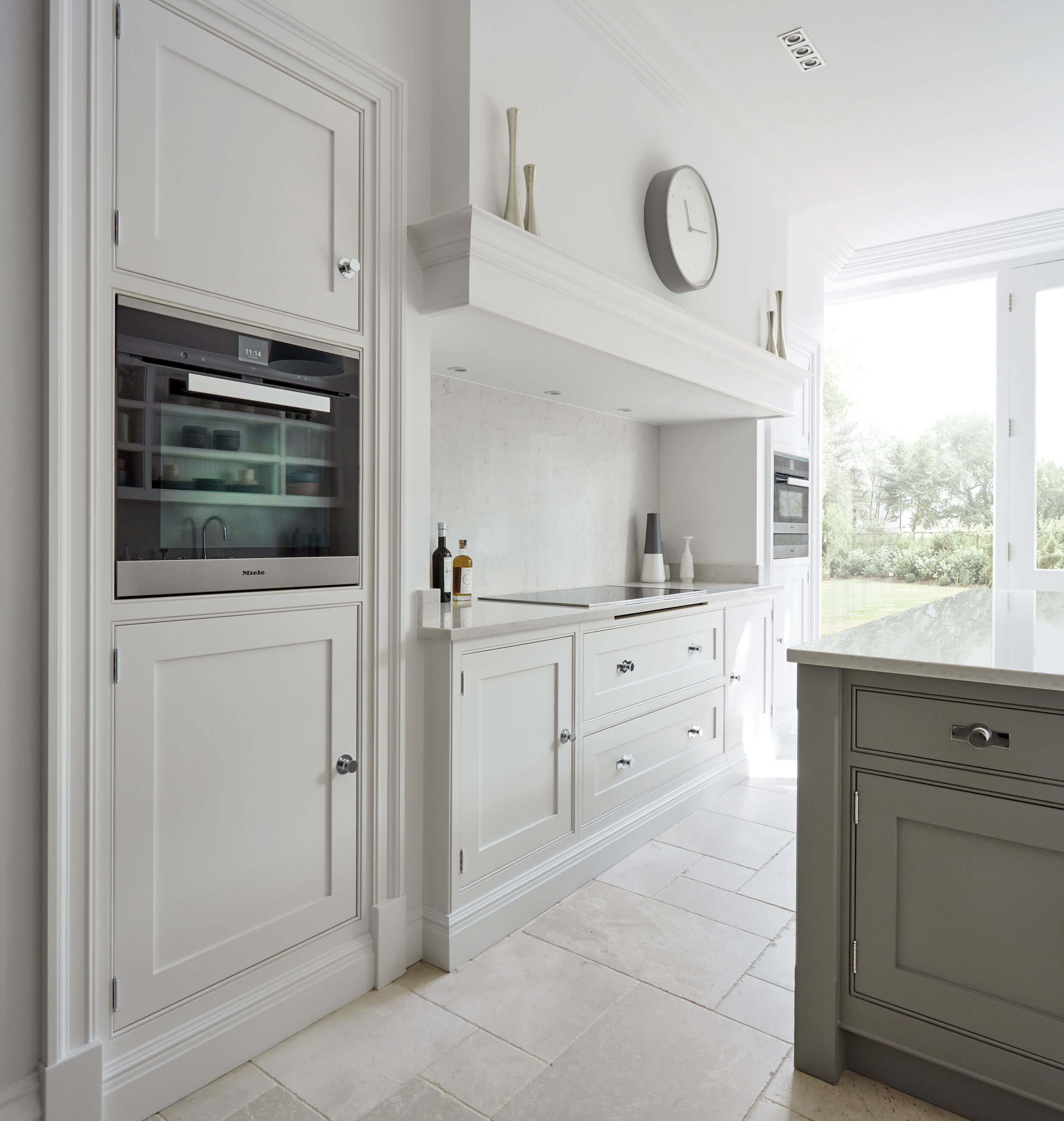 Grey shaker kitchen tom howley small details like the beaded frames on the cabinets and chamfered edges on the pilasters update the classic shaker design for this modern grey kitchen workwithnaturefo